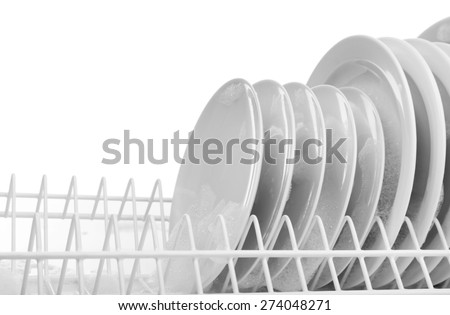 Plates with foam in rack close up - stock photo