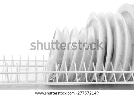 Plates with foam in rack isolated on white - stock photo