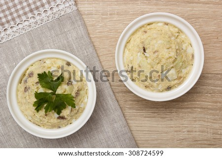 Plates with Forshmak before serving lunch. Jewish cuisine. - stock photo