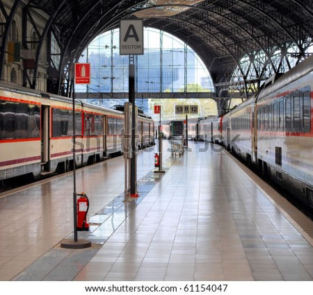 platform and cars at the station in barcelona, spain - stock photo