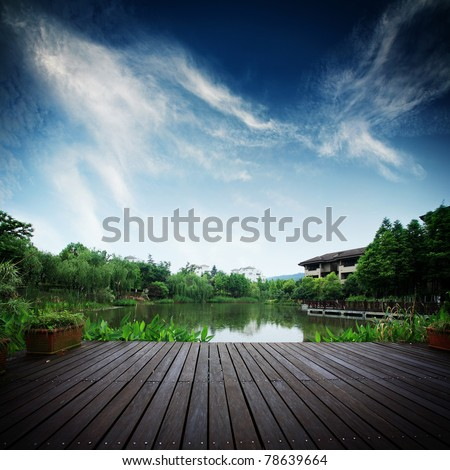 platform beside lake in park - stock photo