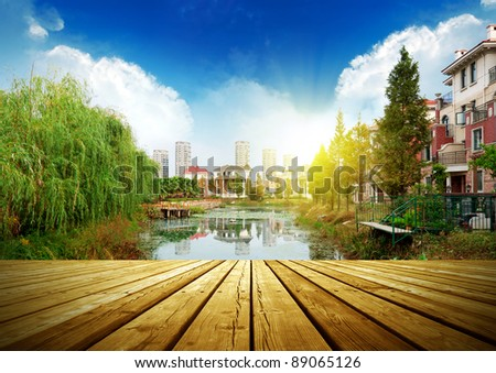 platform beside lake with sunset in park - stock photo