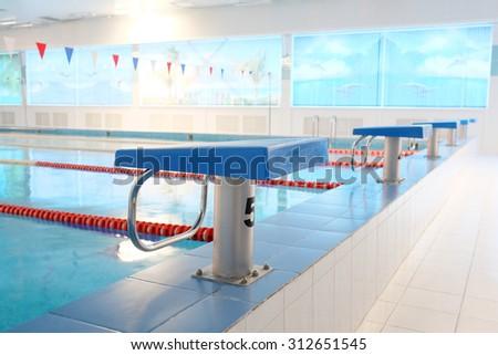 Platform for start and lane of swimming pool - stock photo