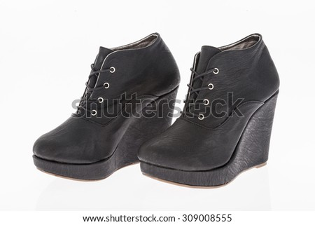 platform shoes made of black leather with laces on white background