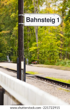 Platform 1 signpost of a railroad station at the countryside/Railway Station Platform Sign - stock photo