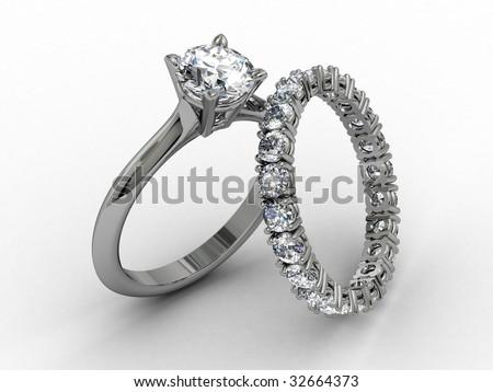 platinum diamond wedding ring set on matt white background - stock photo