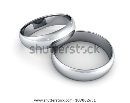 Platinum or silver wedding rings on white background - stock photo