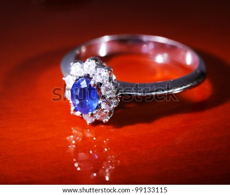Platinum ring with diamonds and blue   sapphire