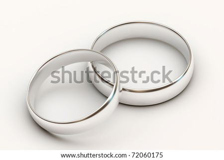 Platinum wedding rings on white background