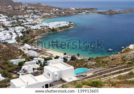 Platis gialos and the famous Psarou beach at Mykonos island in Greece - stock photo