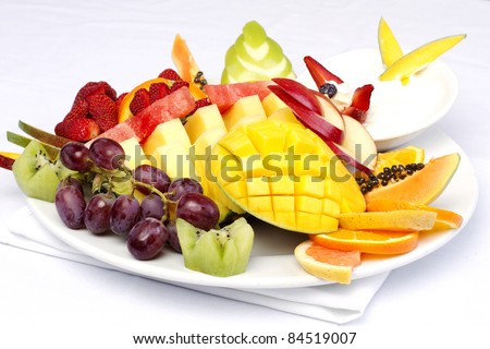 Platter of a assorted fresh fruit cut professionally - stock photo