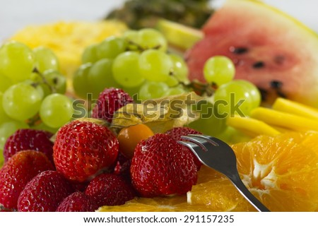 Platter of a assorted fresh fruits cut professionally - stock photo