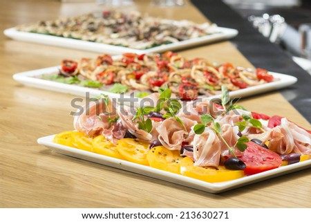 Platter of antipasti and appetizers - stock photo