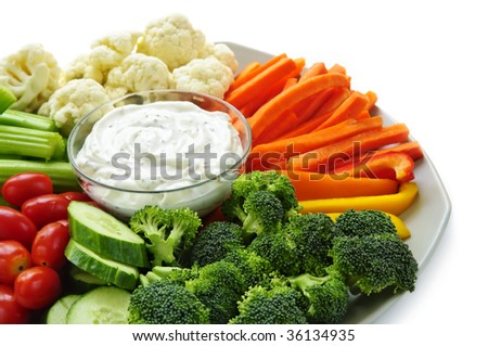 Platter of assorted fresh vegetables with dip - stock photo