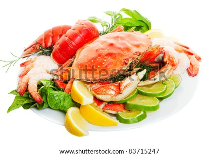 Platter of crab and lobster tails, focus on the crab. - stock photo