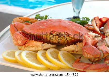Platter of crab on a table at poolside - stock photo