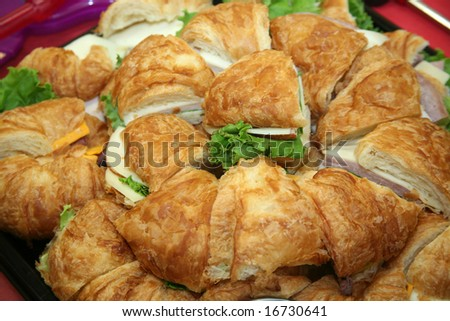 Platter of deli turkey and cheese sandwiches - stock photo