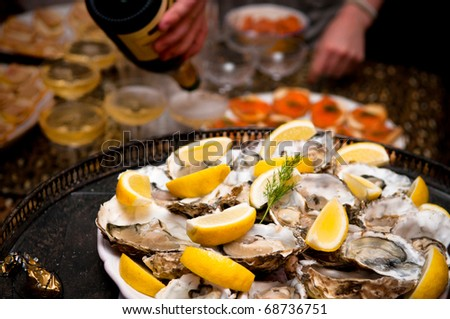 Platter of Oysters and serving champagne - stock photo