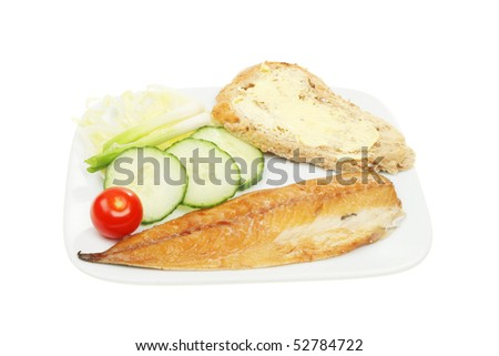 Platter of smoked mackerel salad and bread isolated on white