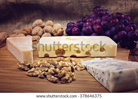 platter with different types of cheese and nuts - stock photo