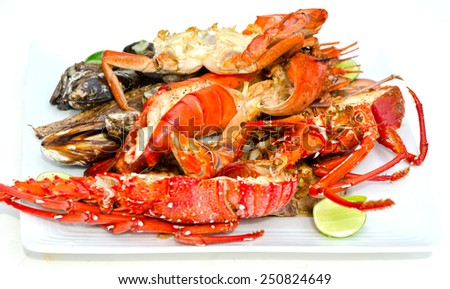 Platter with lobster, mussels, fish and prawns - stock photo
