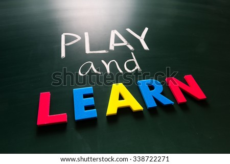 Play and learn concept, colorful words on blackboard