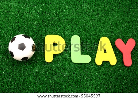 Play ball on atificial turf - word plastic colours