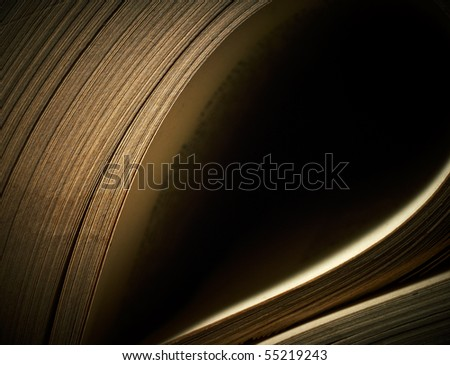 Play of light on old sheets of antique books. Macro. With space for text. - stock photo