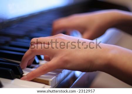 Play piano key. - stock photo