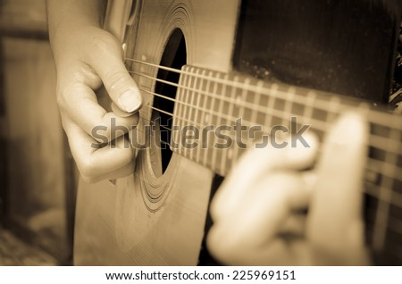 play the guitar with antique effect - stock photo