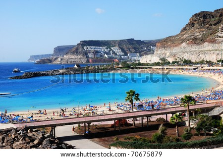 Playa de Amadores, Puerto Rico, Gran Canaria. Beautiful blue flag beach on the south-west coast of Gran Canaria between Puerto Rico and Puerto Mogan - stock photo