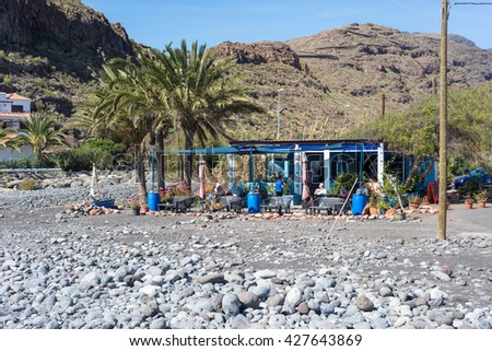 PLAYA DE SANTIAGO, LA GOMERA, SPAIN - FEBRUARY 13. Little restaurant at the beach from Playa de Santiago on the canary island La Gomera February 13, 2016. The village is in the south of the island - stock photo