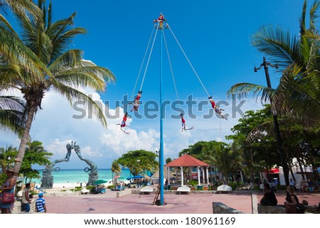 """PLAYA DEL CARMEN, MEXICO - JUNE 28 - Voladores (acrobat performers) at """"Flying Men Dance"""" ceremony on June 28, 2013. The ritual pleased the rain god Xipe Totec and was started in 5th Century. - stock photo"""