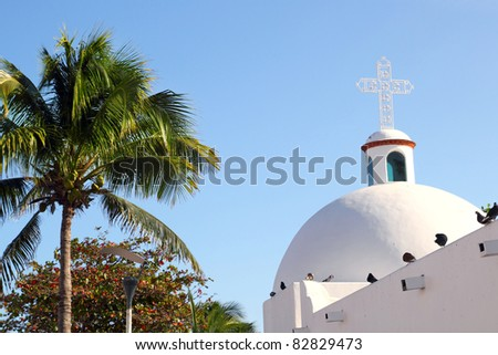 Playa del Carmen white Mexican church with arch and belfry in Mayan Riviera Mexico - stock photo