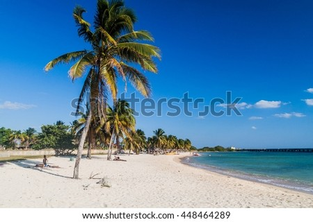 PLAYA GIRON, CUBA - FEB 14, 2016: Tourists at the beach Playa Giron, Cuba. This beach is famous for its role during the Bay of Pigs invasion.