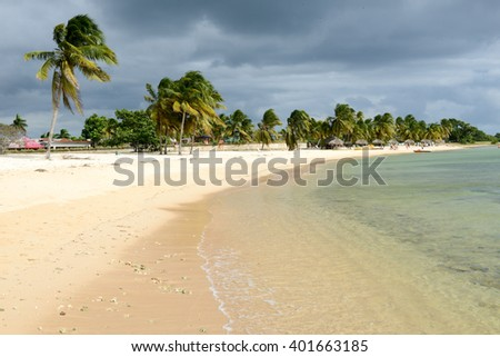 Playa Giron, Cuba - 19 january 2016: people he peaceful sandy beach named Playa Giron which are on the southern part of Cuba