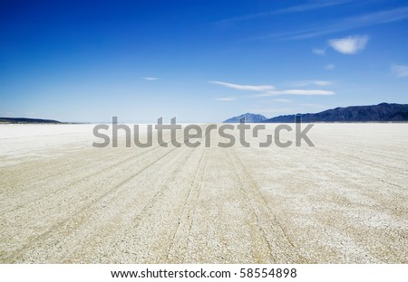 Playa of the Black Rock Desert east of Gerlach Nevada showing vehicle track marks. - stock photo