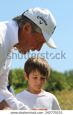 PLAYER, GARY - NOVEMBER 15: Tournament presenter and grand master Gary Player  at his Charity Inv. Golf Tournament with grandson, son of Mark Player on November 15, 2015, Sun City, South Africa.  - stock photo