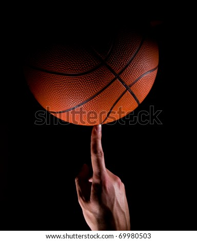 Player Holds a Basketball - stock photo