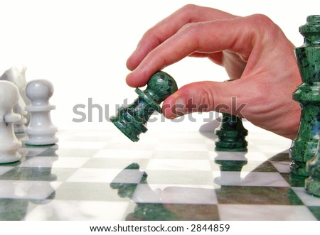 Player moving a chess piece across the board - stock photo