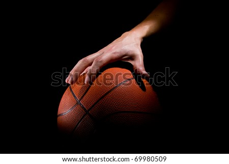 Player plays with a basketball - stock photo