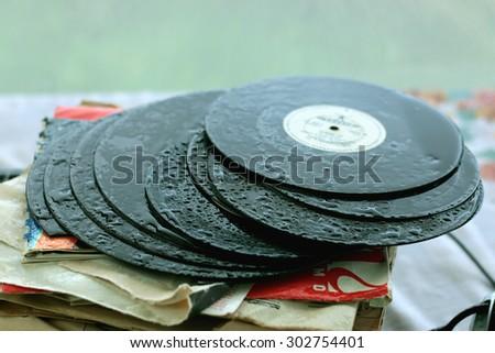 player with headphones on vinyl plates - stock photo