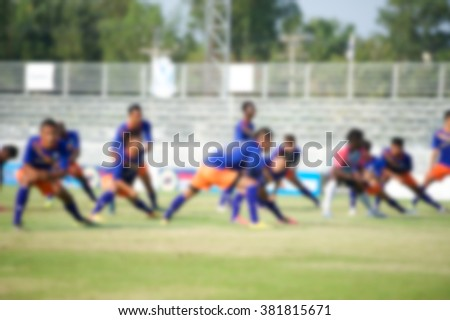 Players in action playing football, Stretching (soccer) - stock photo