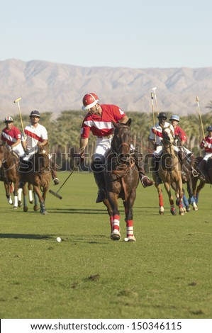 Players playing match on polo field - stock photo
