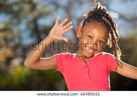 Playful African American girl enjoying nice sunny day - stock photo