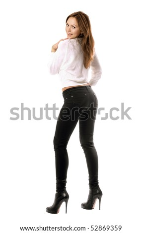 Playful beautiful girl in black tight jeans. Isolated