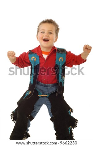 Playful boy dressed up in a cowboy outfit - stock photo