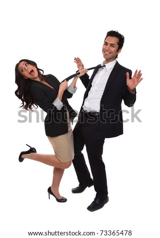 Playful business people at the studio isolated on white - stock photo