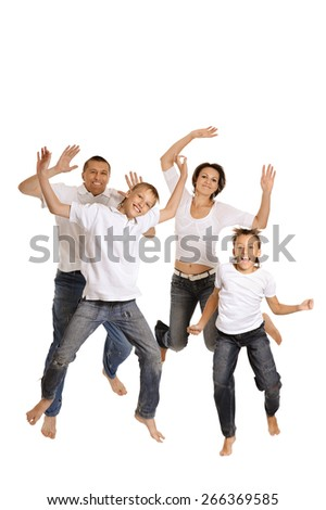 Playful family in bright T-shirts on a white background