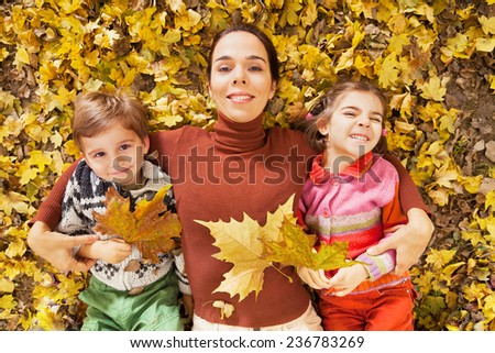 Playful family relaxing in a nature on a autumn day - stock photo